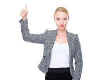 Femme d'affaires avec le pouce vers le haut Photographie stock