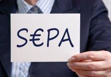 Femme d'affaires avec le signe de SEPA Photo stock