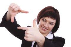 Femme d'affaires avec les mains de encadrement Photos stock