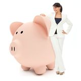Femme d'affaires avec un piggybank Photo stock