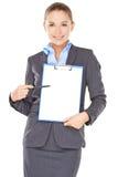 Femme d'affaires avec un presse-papiers vide Photographie stock libre de droits