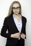 Femme d'affaires blonde sur le fond blanc Photographie stock libre de droits
