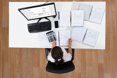 Femme d'affaires Calculating Finance Photographie stock