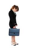 Femme d'affaires chargée sur le blanc Photographie stock