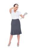 Femme d'affaires chique étonnée tenant le journal Images libres de droits