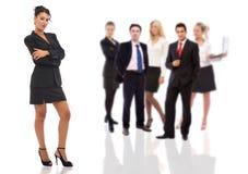 Femme d'affaires confiante et son équipe photo libre de droits
