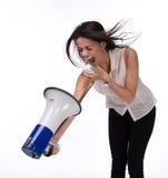 Femme d'affaires criant à elle-même avec le mégaphone Image stock