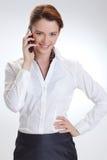 Femme d'affaires dans le bureau avec le telephon Photos libres de droits