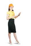 Femme d'affaires dans le casque antichoc Photographie stock