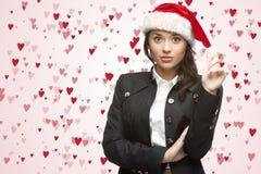 Femme d'affaires dans le chapeau de Santa Photo libre de droits