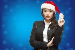 Femme d'affaires dans le chapeau de Santa Images stock