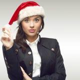 Femme d'affaires dans le chapeau de Santa Photographie stock libre de droits