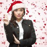Femme d'affaires dans le chapeau de Santa Photos libres de droits
