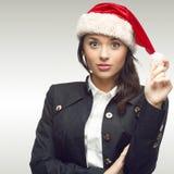 Femme d'affaires dans le chapeau de Santa Photos stock