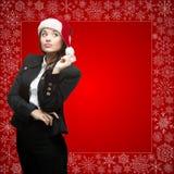 Femme d'affaires dans le chapeau de Santa Photographie stock