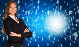 Femme d'affaires dans le costume avec des icônes de personnes Photographie stock libre de droits