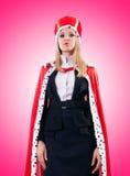 Femme d'affaires dans le costume royal contre le gradient Photo libre de droits