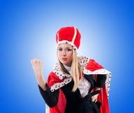 Femme d'affaires dans le costume royal d'isolement sur le blanc Images stock