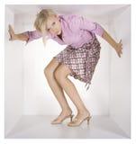 Femme d'affaires dans le cube blanc Image stock