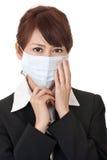 Femme d'affaires dans le masque protecteur Images stock