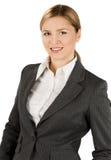 Femme d'affaires dans le procès gris Photo libre de droits