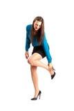 Femme d'affaires dans le stylet tenant sa cheville photo libre de droits