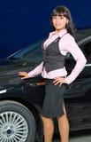 Femme d'affaires dans le système de véhicule Image stock
