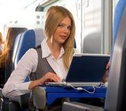 Femme d'affaires dans le train Photographie stock