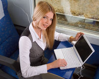 Femme d'affaires dans le train Photos libres de droits