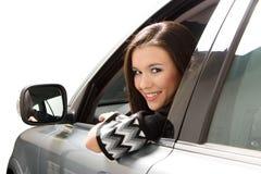 Femme d'affaires dans le véhicule Image stock