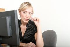 Femme d'affaires dans un bureau Photographie stock