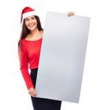 Femme d'affaires de Noël tenant le signe vide Photos stock