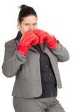 Femme d'affaires de poids excessif et grosse dans des gants de boxe photo stock