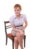 Femme d'affaires de Portpait s'asseyant sur une présidence Image stock