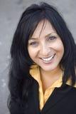 Femme d'affaires de sourire heureuse. Image stock