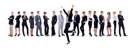 Femme d'affaires de Succesfull et son équipe Photographie stock libre de droits