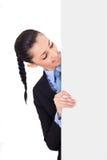 Femme d'affaires derrière le panneau blanc, Photos stock
