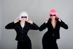 Femme d'affaires deux en glaces pour le film 3d Photographie stock libre de droits