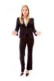 Femme d'affaires donnant les deux mains semblant perplexes Photographie stock libre de droits