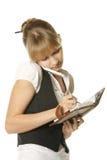 Femme d'affaires effectuant des notes Photographie stock