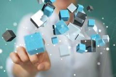 Femme d'affaires employant le renderin brillant bleu de flottement du réseau 3D de cube Photo stock
