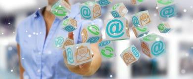 Femme d'affaires employant le rendu de flottement du contact 3D de cube Image libre de droits