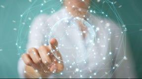 Femme d'affaires employant le rendu de la sphère 3D de réseau de la terre de planète Photo stock