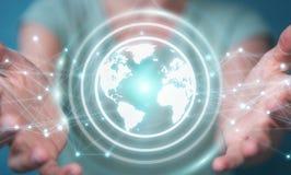 Femme d'affaires employant le rendu de la sphère 3D de réseau de la terre de planète Photographie stock libre de droits