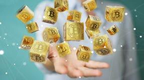Femme d'affaires employant le rendu du cryptocurrency 3D de bitcoins Photographie stock libre de droits