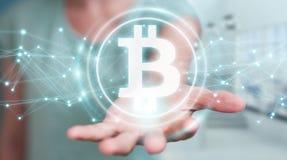 Femme d'affaires employant le rendu du cryptocurrency 3D de bitcoins Images stock