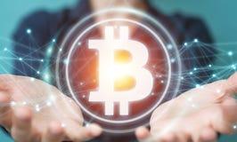 Femme d'affaires employant le rendu du cryptocurrency 3D de bitcoins Photos libres de droits