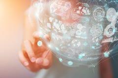 Femme d'affaires employant le rendu numérique de la sphère 3D de données d'hologrammes Image stock