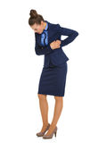 Femme d'affaires en douleur jugeant latérale et regardant vers le bas Photographie stock