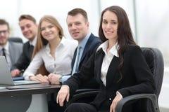 Femme d'affaires et équipe d'affaires Photographie stock libre de droits